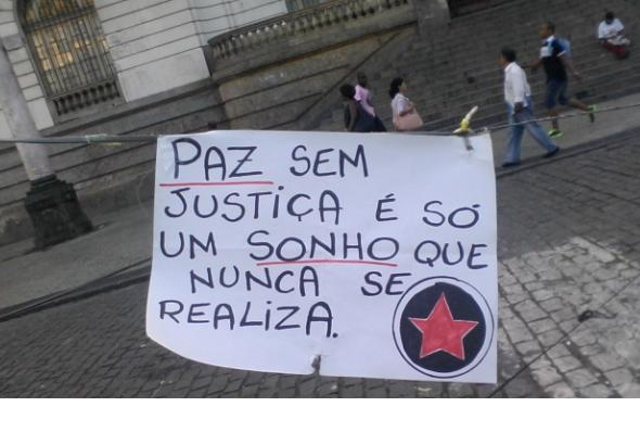 """""""peace without justice can only be a dream without getting real"""" a banner at the picket at camara square in november"""